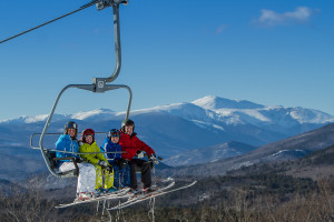 Family on ski lift near Attitash Marketplace Motel.