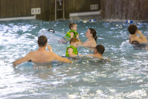 Family swimming at Spa services at Hope Lake Lodge & Indoor Waterpark.