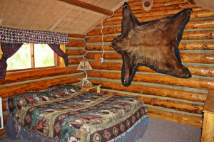 Cabin bedroom at Absaroka Mountain Lodge.