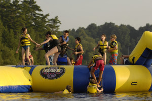 Jumping on the water trampoline at Tyler Place Family Resort.
