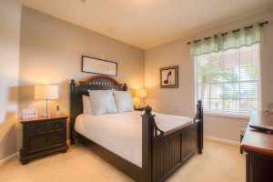 Guest bedroom at Orlando Luxury Escapes Vacation Rentals.