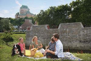 Family in park near Fairmont Le Chateau Frontenac.