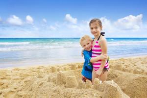 Family on beach at Shoreline Properties.