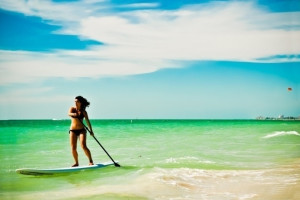 Paddle boarding at Travel Resort Services, Inc.