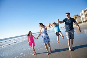 Family on beach at Condo World.