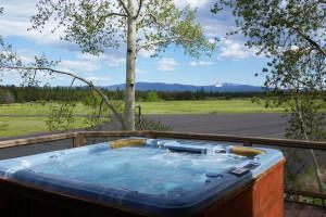 Vacation rental hot tub at Discover Sunriver Vacation Rentals.