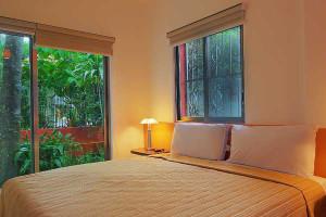 Guest room at Riveria Maya Suites.