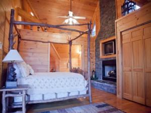 Cabin bedroom at Mountain Getaway Cabin Rentals.