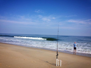 Fishing on the beach at Beach Realty & Construction.