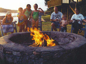 Family by the campfire at Sunset Inn Resort.
