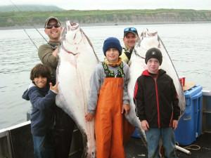 Family fishing at Alaska's Kodiak Island Resort.