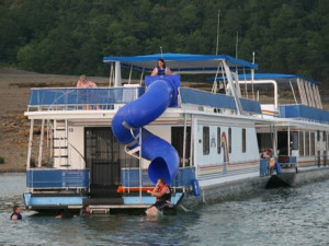Houseboat with water slide boat at Jamestown Resort and Marina.