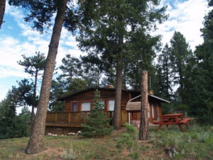 Cabin exterior at Red Door Vacation Rentals.
