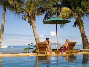 Couple by the pool at Bequa Lagoon Resorts.
