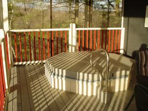 Cottage hot tub at Bayview Wildwood Resort.