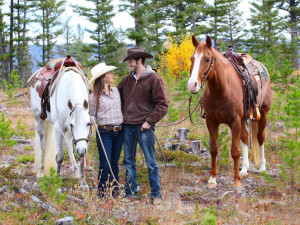 Couple horseback riding at YD Guest Ranch.
