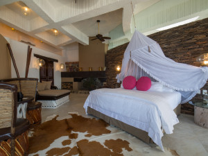 Penthouse bedroom at Ocho Cascadas Resort.