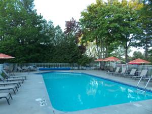 Outdoor pool at Waterbury Inn Condominium Resort.