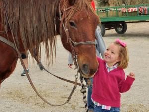 Child with horse at Lajitas Resort.
