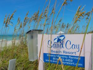 Sand Cay Beach Resort sign.