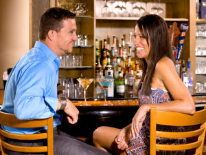 Couple at bar at Golden Arrow Lakeside Resort.