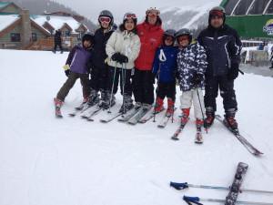 Family skiing at Banff Lodging Company.