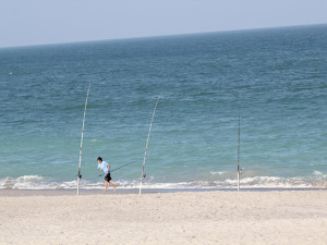 Fishing on beach at Tuckaway Shores Resort.