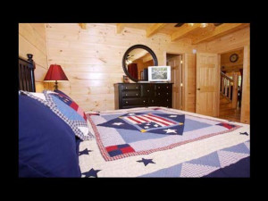 Cabin bedroom at Eden Crest Vacation Rentals, Inc. - American Bear.