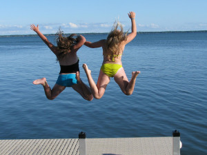 Jumping in the lake at Ottertail Beach Resort.