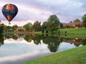 Hot air balloon over lake at The Boar's Head.