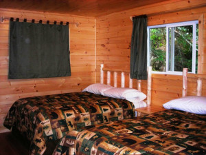 Cabin bedroom at Shady Roost Lodge.