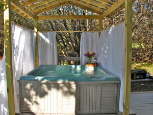 Hot tub at Cypress Creek Cottages.