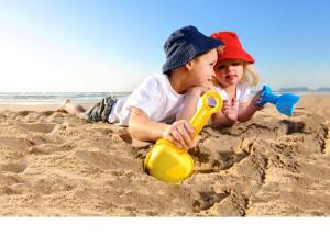 Kids on beach at Elliott Beach Rentals.