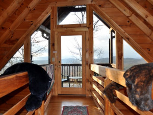 Cabin bedroom at Cuddle Up Cabin Rentals.