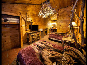 Guest room at Log Cabin Motel & Suites.