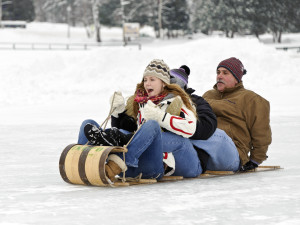 Enjoy fun family sledding at Lake Placid Vacation Homes.