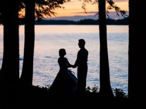 Couple by lake at Northridge Inn & Resort.