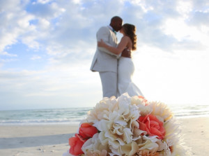 Wedding couple on beach at TradeWinds Island Grand.
