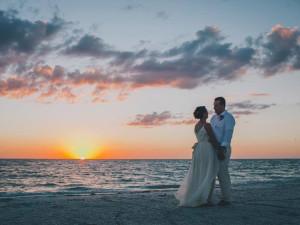 Wedding couple on beach at Palm Island Resort.