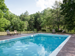 Outdoor pool at Meadow Lane Lodge and Cottages.