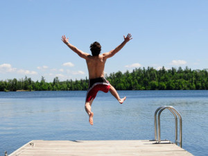 Jumping in the lake at Lakeside Lodge & Suites.