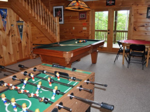 Cabin game room at Cuddle Up Cabin Rentals.