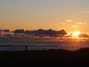 Sunset on the beach at Manzanita Rental Company.