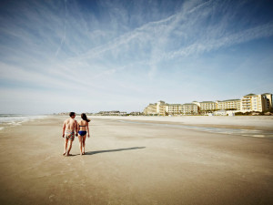 Couple walking on beach at Omni Amelia Island Plantation.