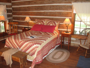 Cabin bedroom at Granbury Log Cabins.