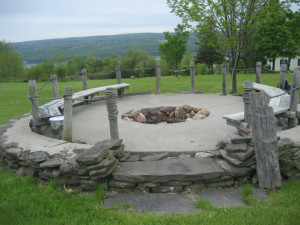 Outdoor patio and fire pit at Seneca Springs Resort.