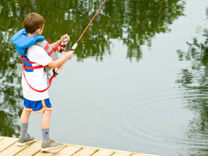 Fishing off dock at Shamrock Bay Resort.