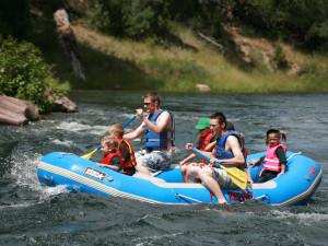 Family rafting at Flaming Gorge Lodge.