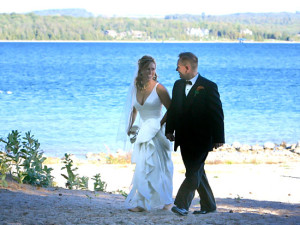 Wedding couple by the lake at Edgewater Inn on the Harbor.