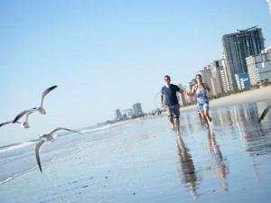 Couple on beach at Caribbean Resort & Villas.